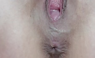 Shaved girl shitting in close up