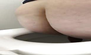 Hot milf shitting in toilet