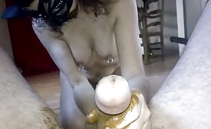 Masked brunette shitting on boyfriend's dick