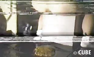 Asian babe shitting on floor