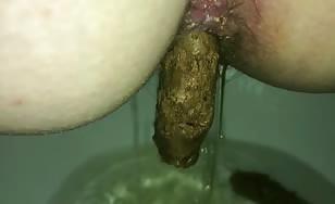 Huge turd stuck in her ass