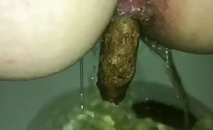 Beautiful babe shits in toilet