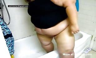 Fat American girl shitting in bathtub