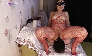 Red fishnets while shitting on her slave